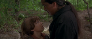 Injun Joe, finding out that Tom was the observer in the graveyard, surprises Tom and threatens to kill him