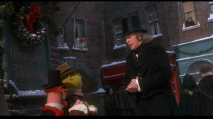 Scrooge, having turned over a new leaf, finds the charity volunteers and offers them a large sum to help the homeless and destitute