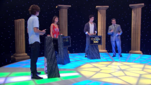 The Russo Family competition is set up like a television game show, with Justin taking an early lead