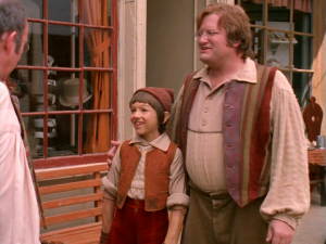 Geppetto takes Pinocchio around the town,introducing the residents to his son