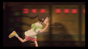 Chihiro runs through the bathhouse, looking for her parents, unable to believe they have been turned into pigs