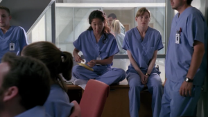 Cristina is seen suturing a banana while they all wait to find why they've been gathered