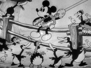 Mickey starts playing a tune for the barnyard musical extravaganza