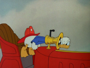 Donald rushes back to the fire at his own station, only to get stuck in the horn after he comes to a sudden stop
