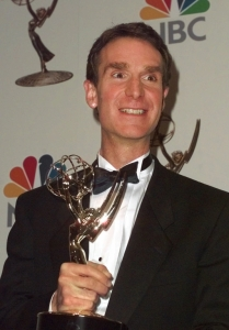 """Bill Nye displays his Emmy statuette during the1998 Daytime Emmy Awards at Radio City Music Hall in New York on Friday, May 15, 1998. Nye won for """"Outstanding Performer in a Children's Series"""" for his role in """"Bill Nye the Science Guy."""" (AP Photo/Mark Lennihan)"""